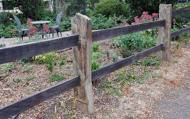 Garden sleepers as fence posts photo