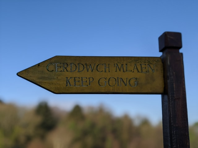 Bilingual sign in Wales showing Welsh and English