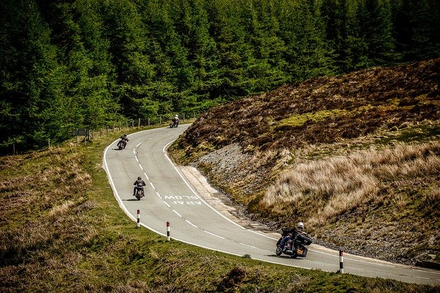 Motorcyclists on a road in Wales