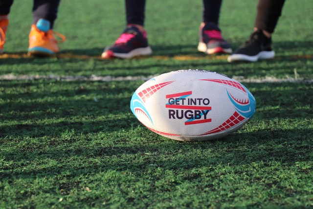 Rugby ball on grass pitch
